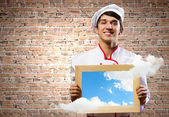 Cook holding photo frame — Foto Stock