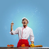Young cheerful cook — Stock Photo