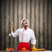Cook and ingredients flying in air — Stock Photo