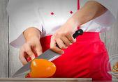 Hands cutting pepper — Stock Photo