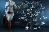 Businesswoman drawing sketches — Stock Photo