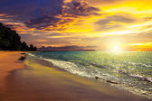 Sunset on Khao Lak beach in Thailand. — Stock Photo
