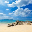 Landscape with white beach, the sea and the beautiful clouds in the blue sky — Stock Photo