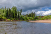 Summer landscape with river and forest in a thunderstorm day — Stock Photo