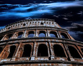 Ancient Roman Colosseum at night in the moonlight — Stock Photo