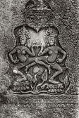 Apsara Dance. Bas-relief on the walls of the ancient Khmer temple of Angkor Thom. — Stock Photo