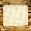Sheet paper on wooden planks — Stock Photo