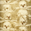 Background with human skulls and bones - Foto Stock