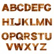 Alphabet - letters from rusty metal with rivets — Stock Photo