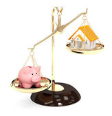 Piggy bank and house on bowls of scales — Stock Photo