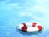 Lifebuoy, floating on waves — Stock Photo