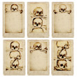 Grunge cards with human skulls and bones - Stock Photo