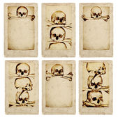 Grunge cards with human skulls and bones — Stock Photo
