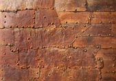 Rusty metal texture with rivets — Stock Photo