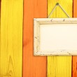 Wooden frame on wooden wall — Stock Photo #27027075