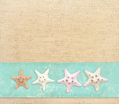 Starfishes on canvas texture — Stock Photo