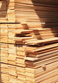 Wooden boards in a warehouse — Stock Photo