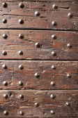 Ancient wood with rivets — Stock Photo