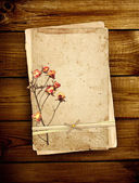 Old card on wooden planks — Photo