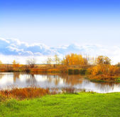 Autumn landscape with a lake — Stock Photo