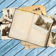 Old book and photos — Stock Photo
