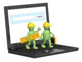 Two builders and laptop — Stock Photo
