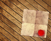 Viejo pergamino sobre tablones de madera — Foto de Stock