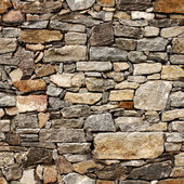 Seamless texture of medieval wall of stone blocks — Stock Photo
