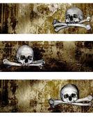 Collectie van banners met menselijke schedels en beenderen — Stockfoto