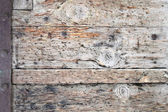 Ancient wood with metal rivets — Stock Photo