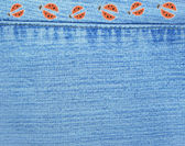 Jeans background with ladybugs — Stockfoto
