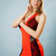 Portrait of a beautiful young woman in red dress — Stock Photo