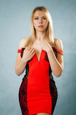 Erotic woman in red dress — Stock Photo