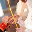 Royalty-Free Stock Photo: Priest is putting ring on bride