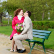 Man and woman having romantic date and kissing — Stock Photo