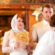 Bride and groom are listening to priest during orthodox wedding — Stock Photo