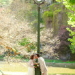 Beautiful just married couple kissing by lantern — Stock Photo