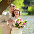 Beautiful just married couple in park at spring — Stock Photo #12013035