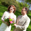 Happy just married couple in park at sunny day — Stock Photo