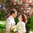 Стоковое фото: Beautiful newlywed couple in park at spring