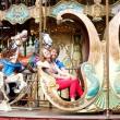 Happy young couple at vintage Parisian merry-go-round — Stock Photo