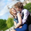 Royalty-Free Stock Photo: Young romantic couple enjoying warm sunny day in Paris, near the