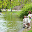 Happy just married couple hugging near the water in park — Stock Photo #12014738