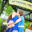 Young romantic couple kissing near metro station in Paris — Stock Photo