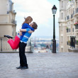 Stock Photo: Young dating couple hugging on Montmartre, girl is jumping