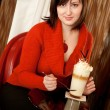 Beautiful young woman with delicious coffee cocktail in cafe — Stock Photo