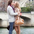 Stock Photo: Romantic couple in Paris kissing