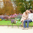 Romantic couple in a park, having a date — Stock Photo #12018591