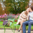 Romantic couple in a park, having a date — Stock Photo #12018673