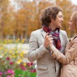 Romantic couple at fall, having a date — Stock Photo
